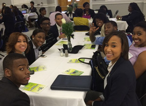 L to Back and Around OT R: David Smalls, Mariah McClain, 